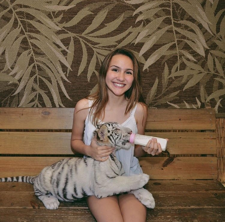 Loving+her+time+with+the+baby+tiger%2C+Sara+Rodriguez+smiles+for+the+camera.+Rodriguez%0Amet+the+tiger+at+a+preservation+in+Myrtle+Beach.