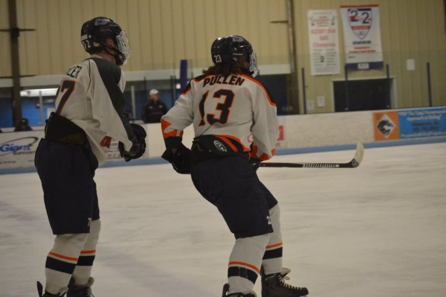 Junior Nathan Pullen skates past a teammate during the senior night game.