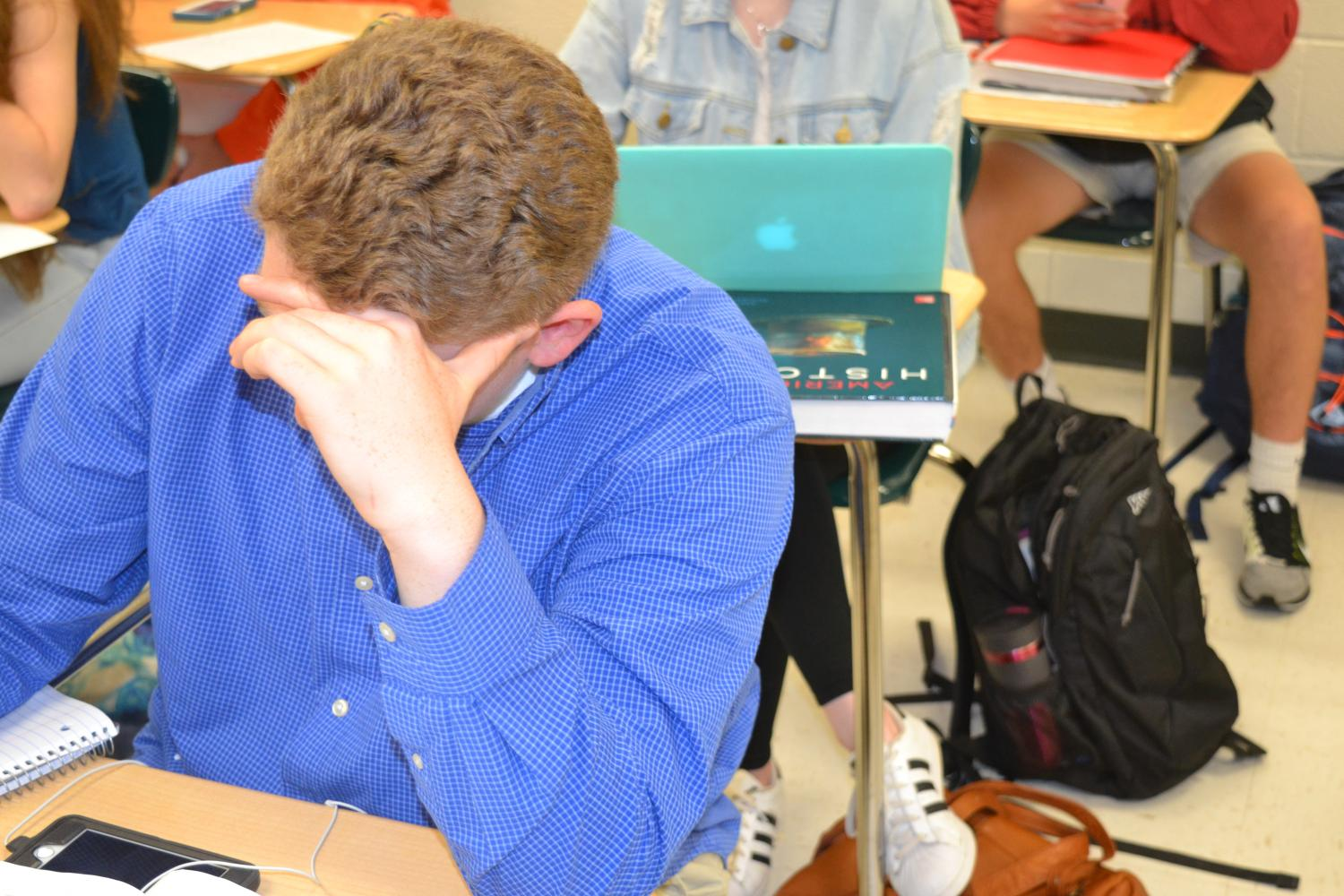 Junior+Matthew+Taylor+stressed+in+AP+US+History.