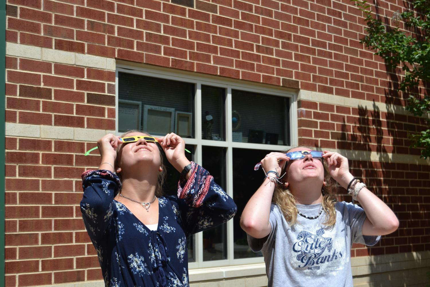 Students take a look up to the sky, trying to catch a glimpse of the solar eclipse.