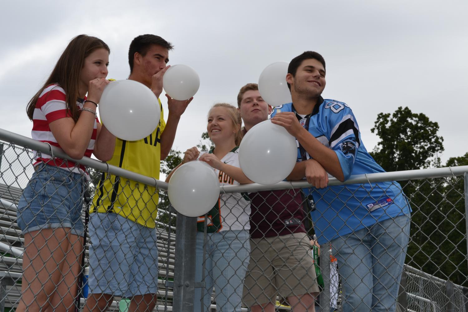 Students hang out after school decorating The Cage.