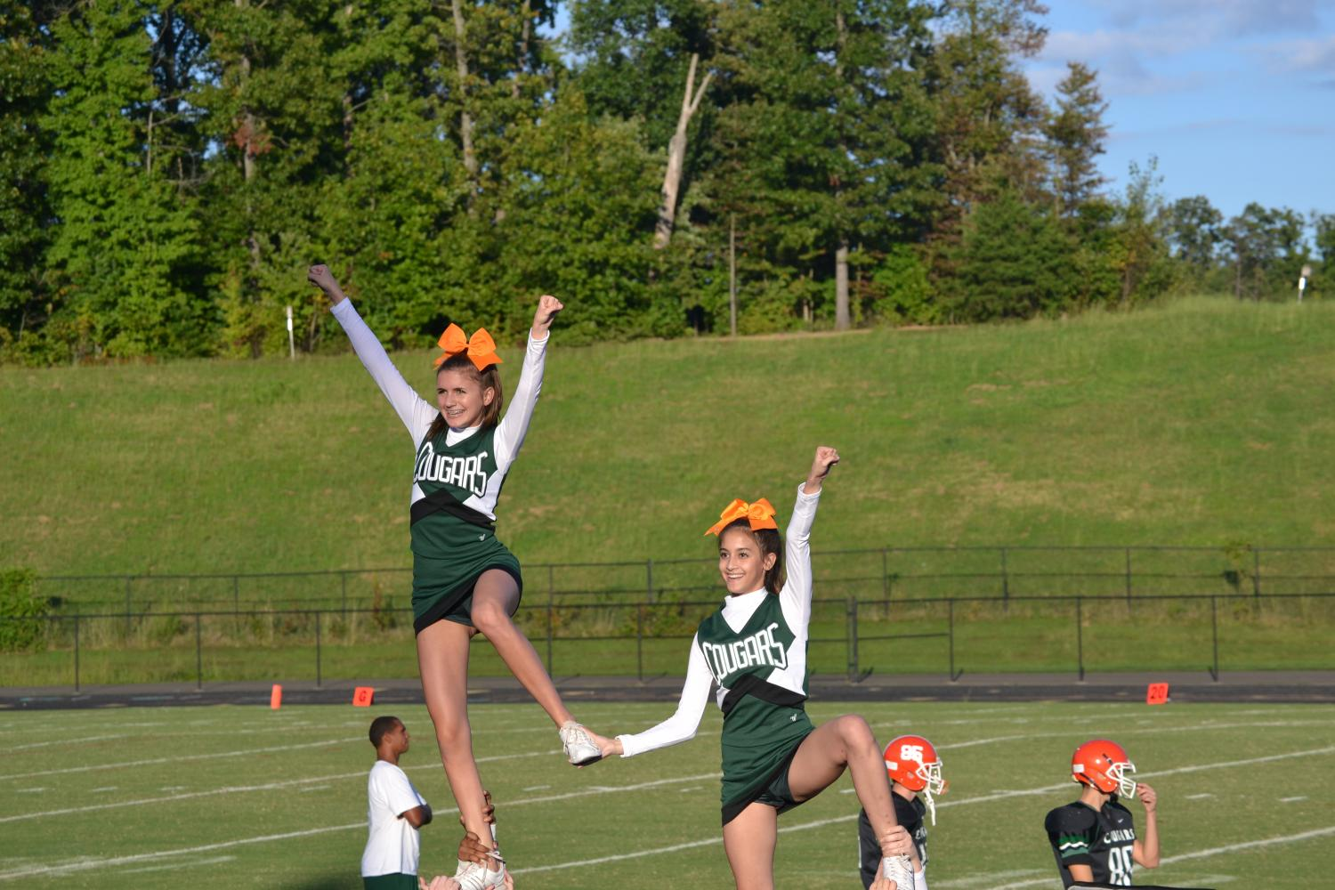 JV Cheerleaders hype up the crowd during a JV Football game.