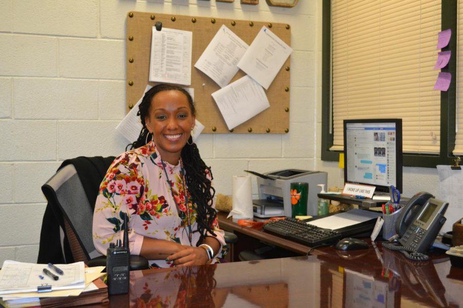 Sitting at her new desk, Assistant Principal Lashonda Reed works toward making students' lives easier.
