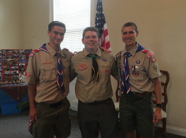 Celebrating the Eagle Scout distinction, seniors Justin Magill (left), Matthew Taylor (middle), and Max McManus (right) attend McManus's Eagle Ceremony.