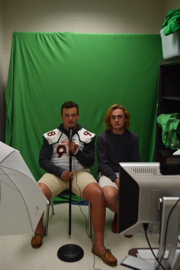 Recording the daily broadcast, junior Logan Morris and senior Nathan Pullen have taken journalism for several years, a class that teaches 21st century skills.