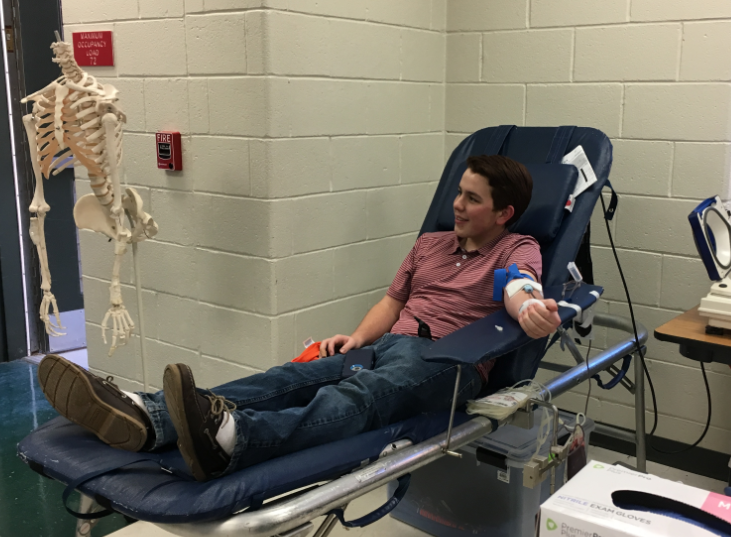 Donating blood, junior Grant Colgan is happy to do his part to help others. The blood drive was hosted by HOSA in honor of National Blood Donation Month.